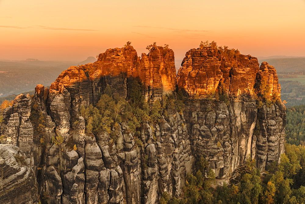Schrammstein rocks at sunrise in Elbe Sandstone Mountains, Germany, Europe