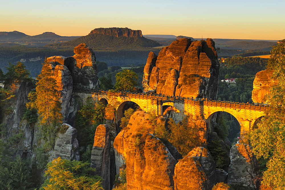 View from Bastei Bridge at sunrise to Lilienstein Mountain, Elbsandstein Mountains, Saxony, Germany
