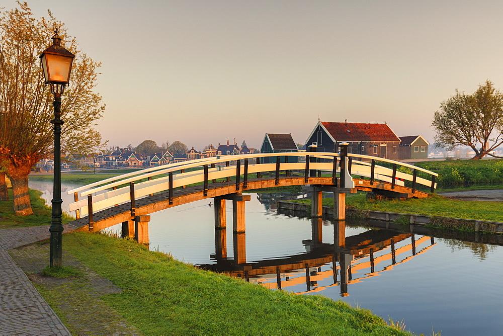 Wooden bridge over Zaan River at sunrsie, open-air museum, Zaanse Schans, Zaandam, North Holland, Netherlands, Europe - 1160-4320