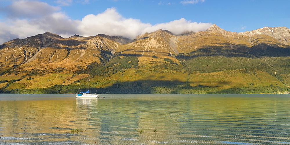 Sailing boat at Glenorchy Lagoon at sunrise, Glenorchy, Otago, South Island, New Zealand, Pacific