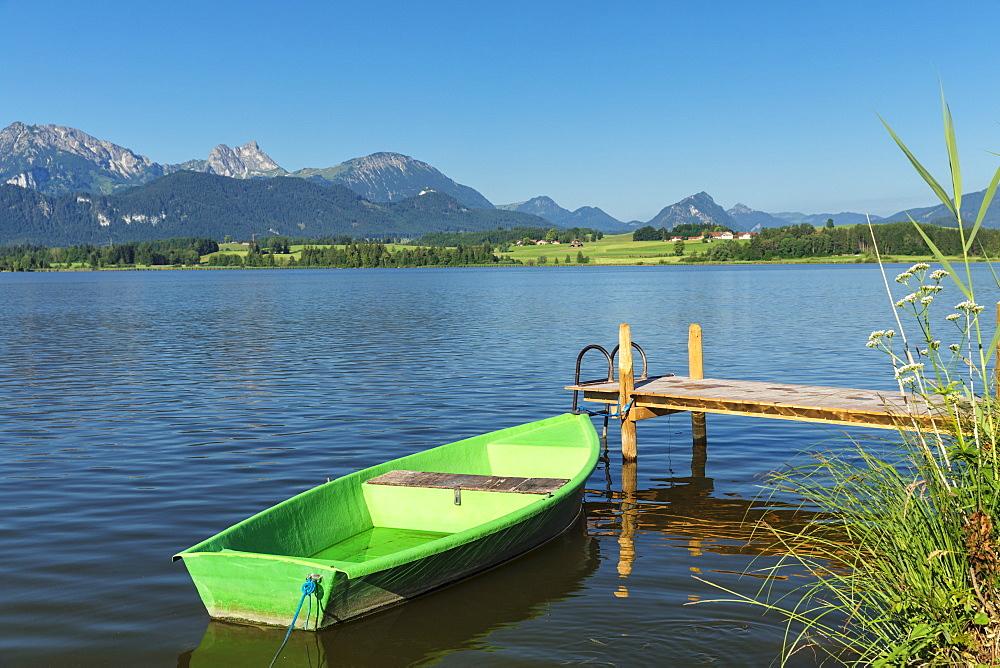 Rowing boat at a jetty, Hopfensee lake, Hopfen am See, Allgau Alps, Allgau, Schwaben, Bavaria, Germany, Europe
