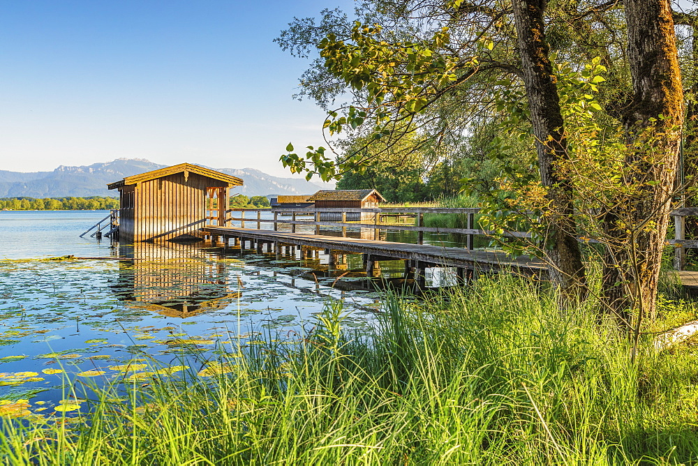 Boat houses on a jetty, Lake Chiemsee, Upper Bavaria, Germany, Europe