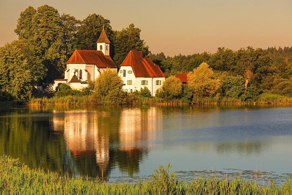 St. Walburgis Church at Seeon Abbey at Lake Seeoner See at sunrise, Chiemgau, Chiemgau Alps, Upper Bavaria, Germany, Europe