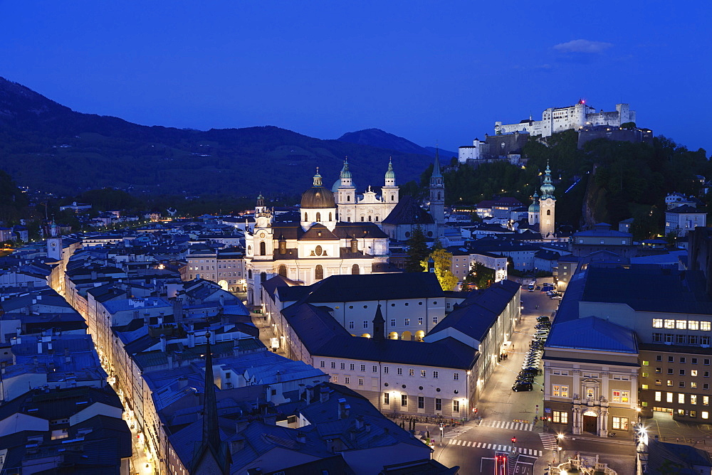 High angle view of the old town with Hohensalzburg Fortress, Dom Cathedral and Kappuzinerkirche Church at dusk, UNESCO World Heritage Site, Salzburg, Salzburger Land, Austria, Europe