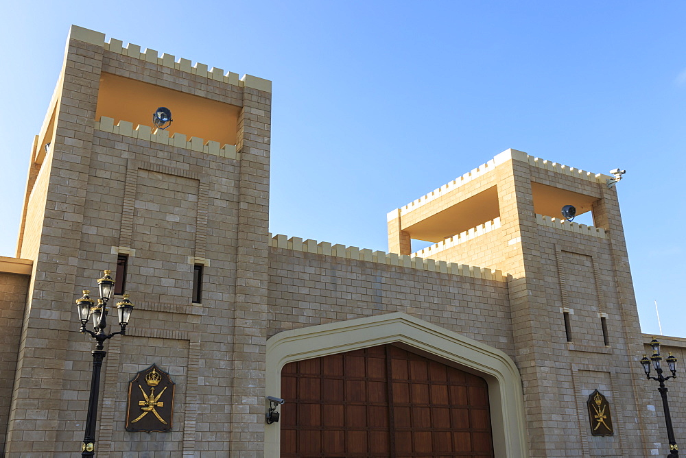 Battlements and huge teak gates of Al-Husn, Sultan's Palace, Salalah, Dhofar Region, Southern Oman, Middle East