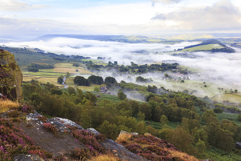 Early morning fog around Curbar village, from Curbar Edge, Peak District National Park, late summer heather, Derbyshire, England, United Kingdom, Europe
