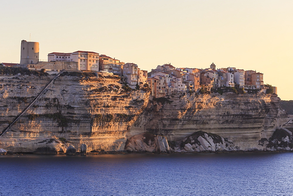 Old citadel at dawn, in early morning light, seen from the sea, Bonifacio, Corsica, France, Mediterranean, Europe