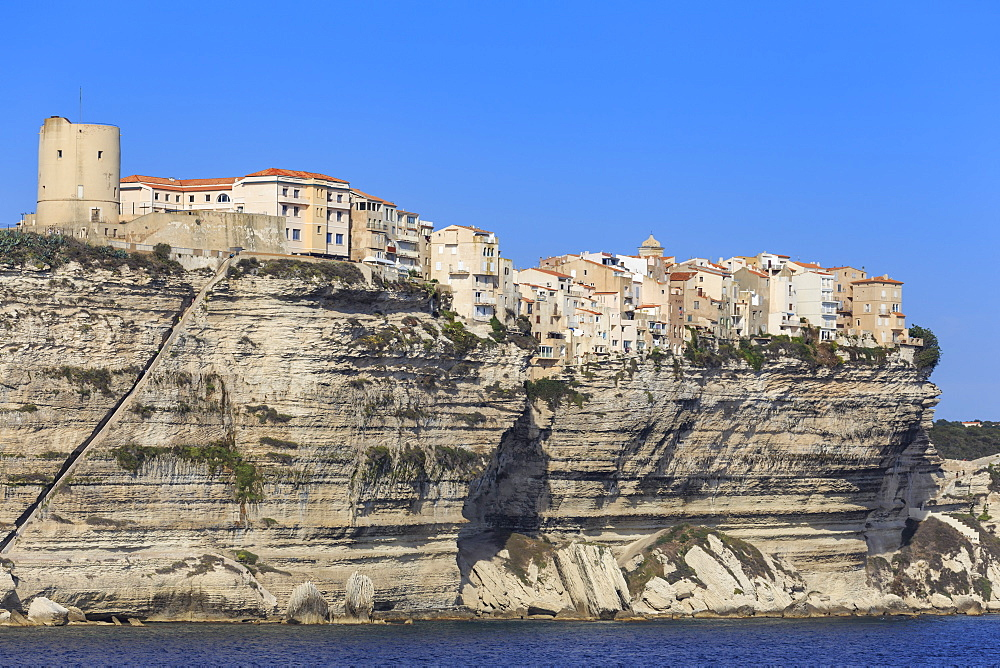 Old citadel, with Aragon steps, atop cliffs, from the sea, Bonifacio, Corsica, France, Mediterranean, Europe