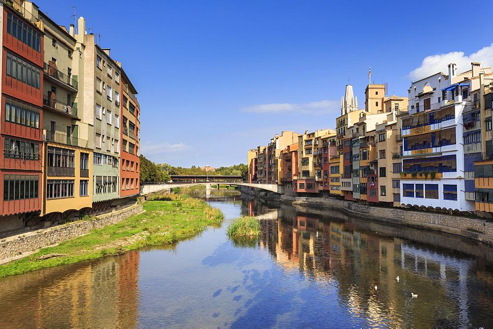 Distinctive historic colourful arcaded houses and Onyar River, Girona, Girona Province, Catalonia, Spain, Europe - 1167-1274