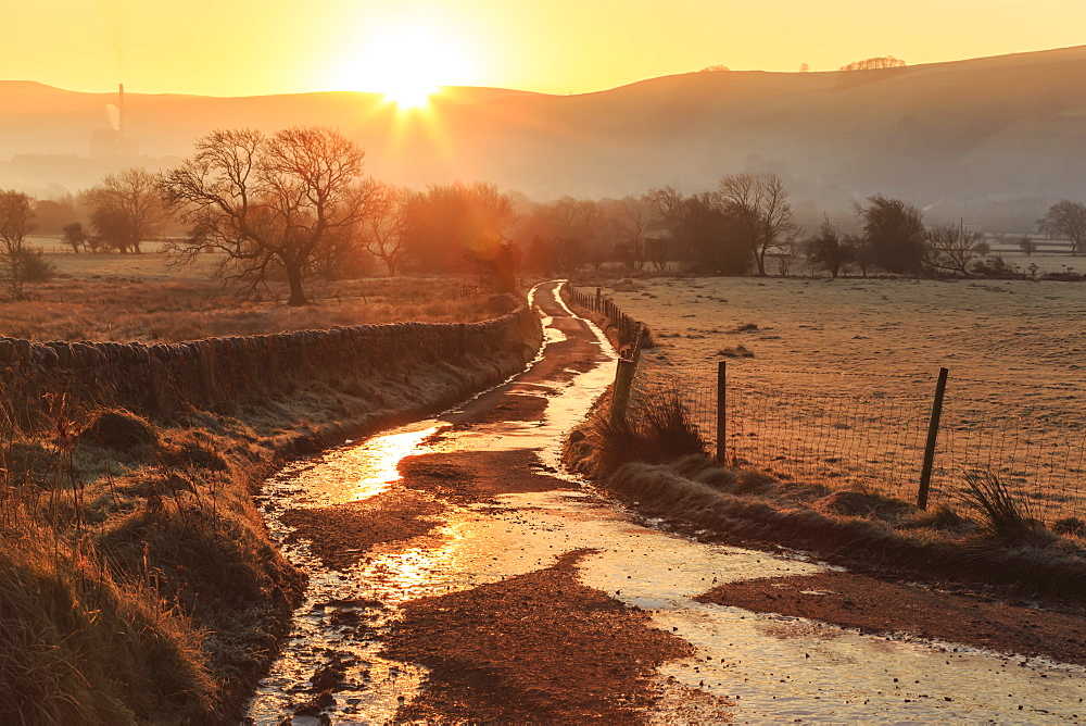 Misty and frosty sunrise over a country lane in winter, Castleton, Peak District National Park, Hope Valley, Derbyshire, England, United Kingdom, Europe - 1167-1278