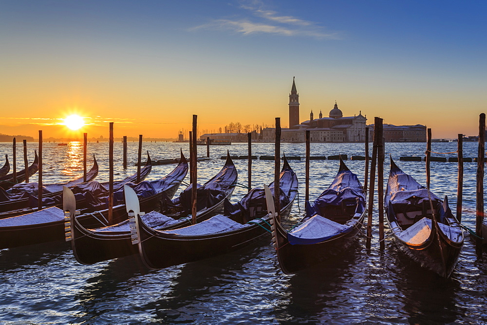 Venetian winter sunrise after snow with gondolas, San Giorgio Maggiore and Lido, Venice, UNESCO World Heritage Site, Veneto, Italy, Europe