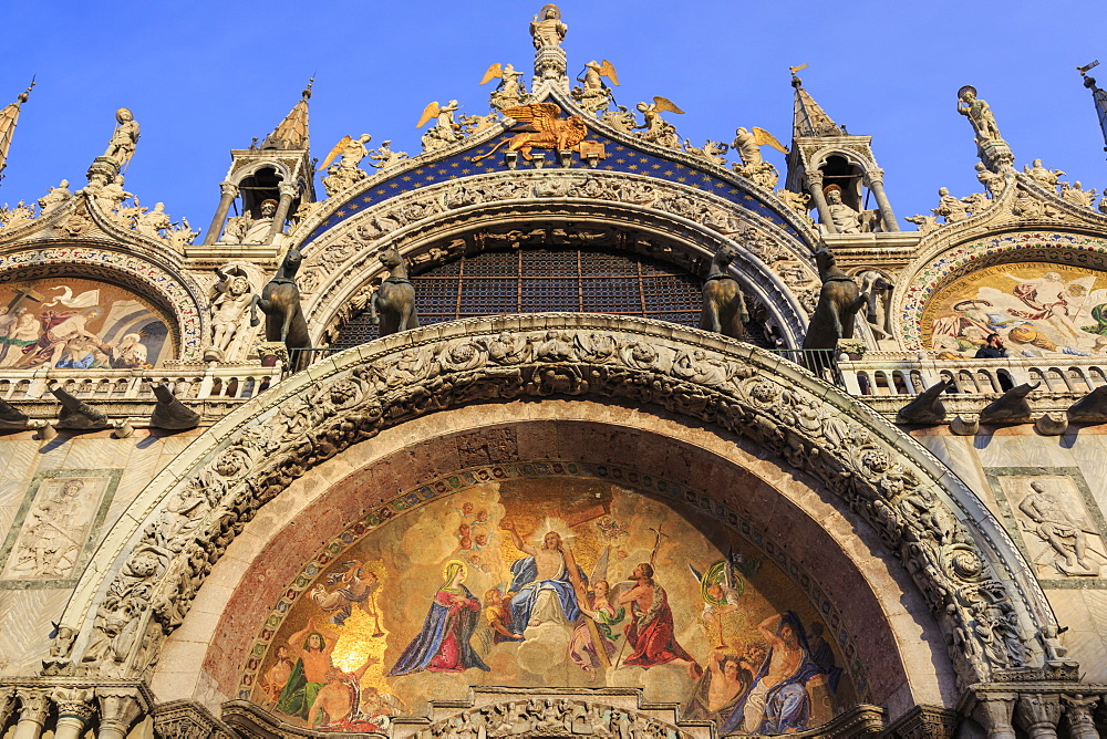 Basilica San Marco golden exterior mosaics in late afternoon sun in winter, Venice, UNESCO World Heritage Site, Veneto, Italy, Europe