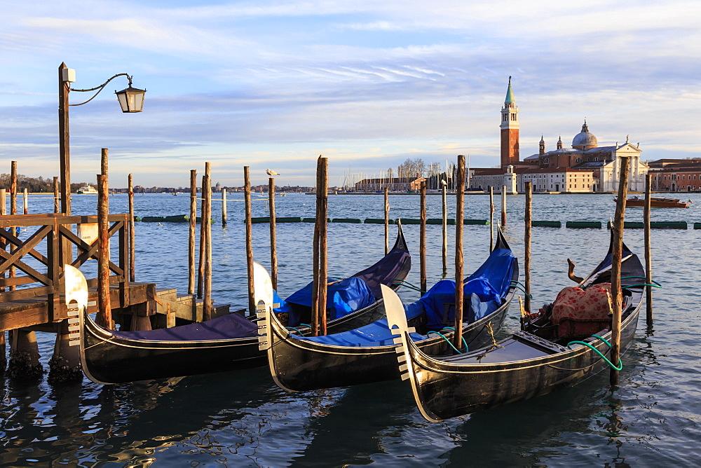 Gondolas, San Marco waterfront at sunset, view to San Giorgio Maggiore, Venice, UNESCO World Heritage Site, Winter, Italy