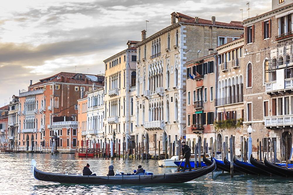 Gondola, La Volta, Grand Canal, elaborate Gothic palazzi at sunset in winter, Venice, UNESCO World Heritage Site, Veneto, Italy, Europe