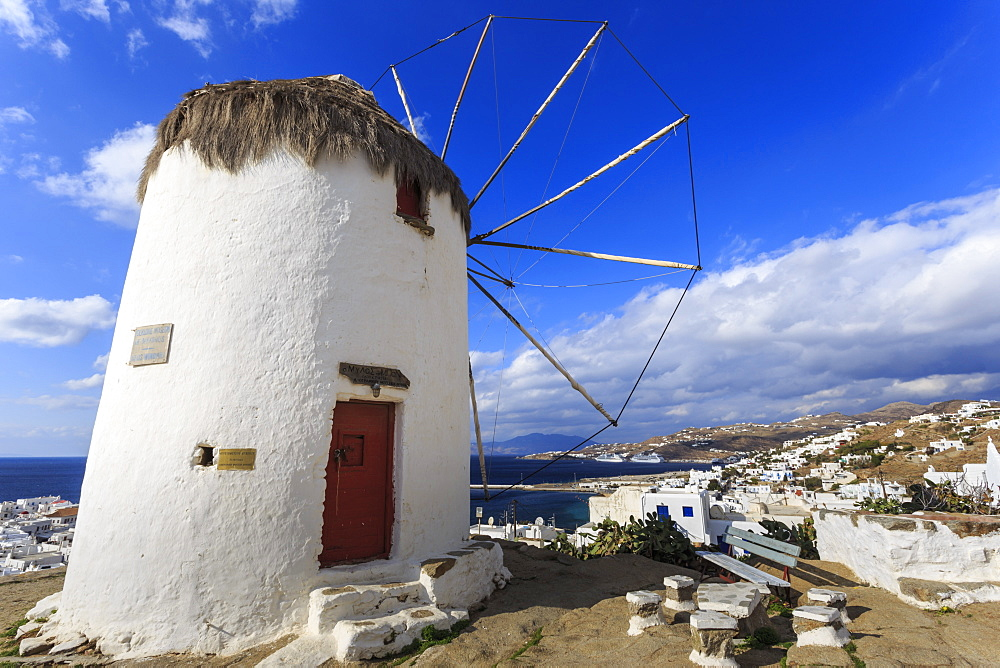 Whitewashed windmill, view of Mykonos Town (Chora) and cruise ships in distance, Mykonos, Cyclades, Greek Islands, Greece, Europe