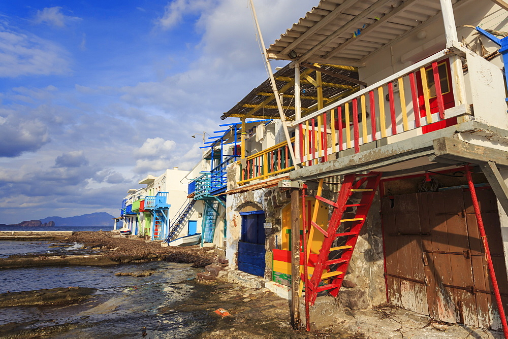 Syrmata, traditional fishermen's encampments with brightly painted woodwork, fishing village of Klima, Milos, Cyclades, Greece