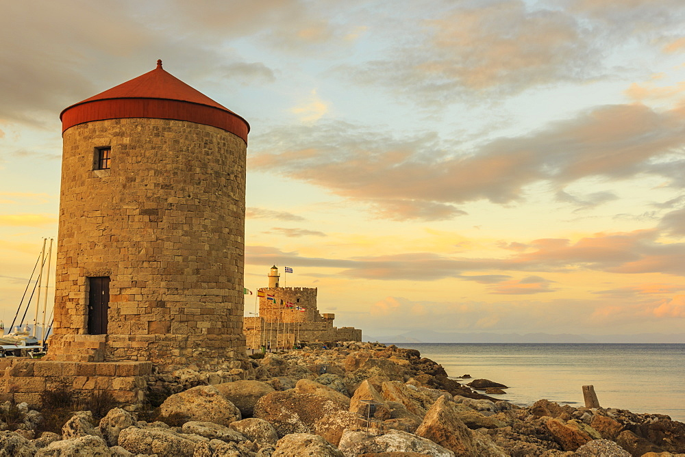 Mandraki Harbour medieval windmill and Fortress at sunset, Rhodes Town, UNESCO World Heritage Site, Rhodes, Dodecanese, Greek Islands, Greece, Europe