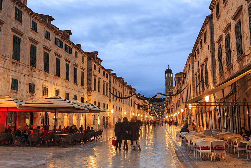 Cafes on Stradun (Placa), pedestrian promenade, evening blue hour, Old Town, Dubrovnik, UNESCO World Heritage Site, Croatia, Europe