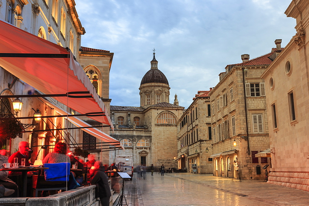 Cathedral and busy outdoor cafe, evening blue hour, Old Town, Dubrovnik, UNESCO World Heritage Site, Dalmatia, Croatia