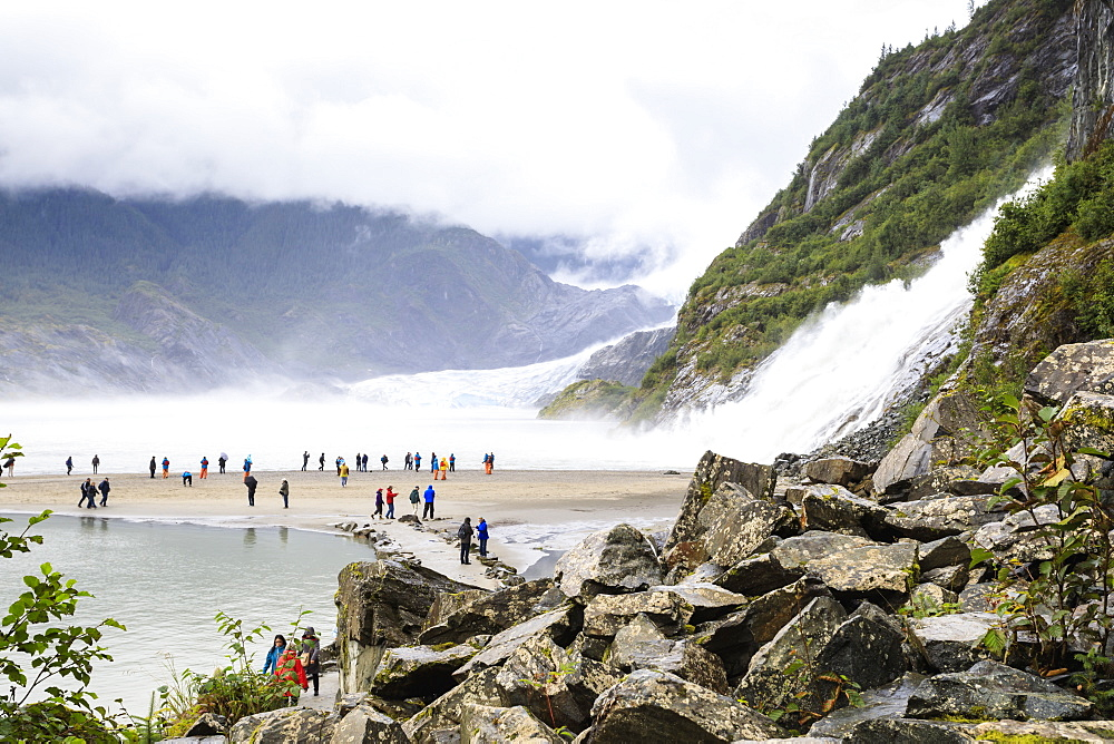 Mendenhall Glacier and Lake, Nugget Falls Cascade, mist, visitors on a beach, Nugget Falls Trail, Juneau, Alaska, United States of America, North America