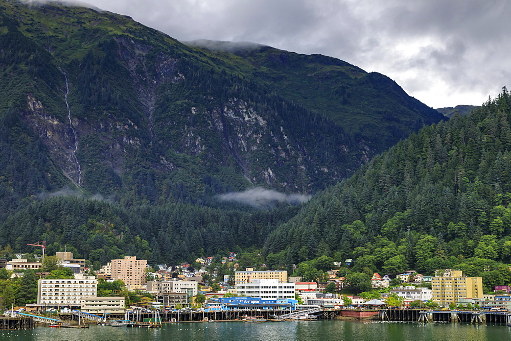 Juneau, State Capital, view from the sea, mist clears over downtown buildings, mountains, forest and float planes, Alaksa, USA