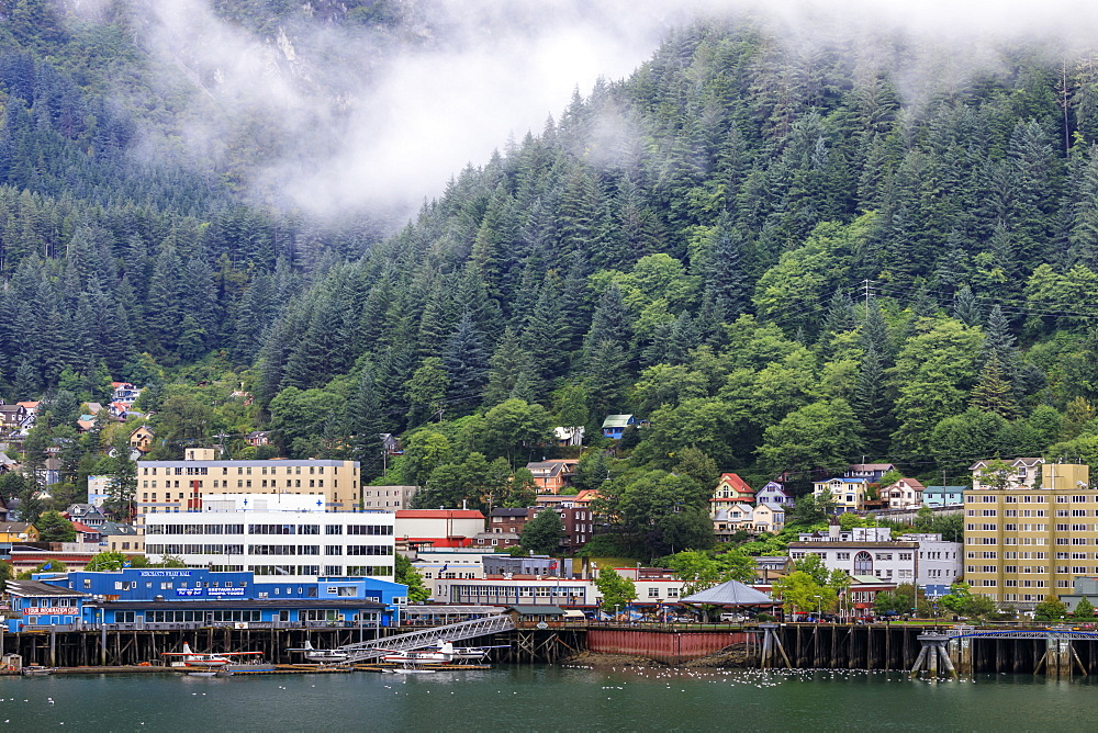 Juneau, State Capital, view from the sea, mist clears over downtown buildings, mountains, forest and float planes, Alaksa, United States of America, North America
