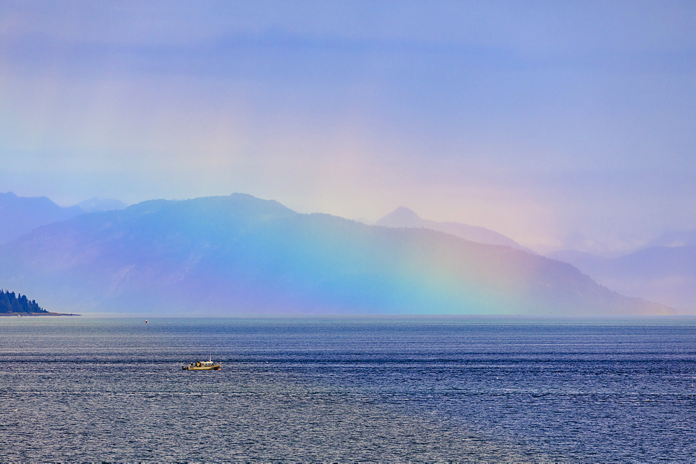 Boat, huge rainbow colours light up mist over the Fairweather Range, Icy Strait, near Glacier Bay, Inside Passage, Alaska, United States of America, North America