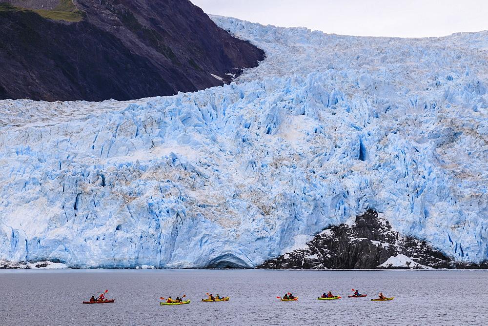 Colourful kayaks, Aialik Glacier, blue ice and mountains, Harding Icefield, Kenai Fjords National Park, near Seward, Alaska, USA - 1167-1629