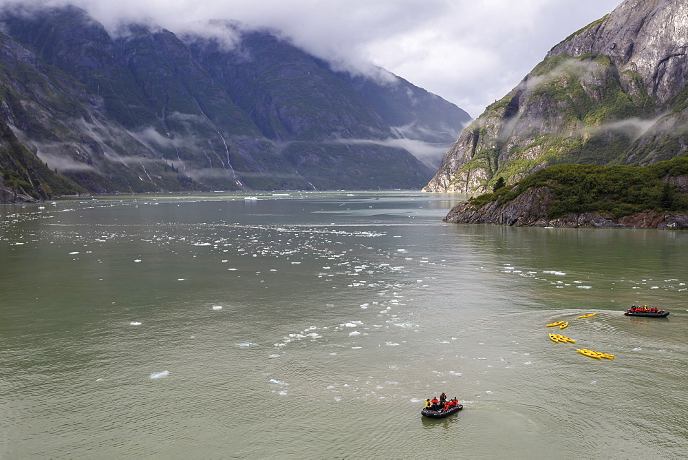 Kayak expedition preparations, Tracy Arm Fjord, clearing mist, icebergs and cascades, near South Sawyer Glacier, Alaska, United States of America, North America