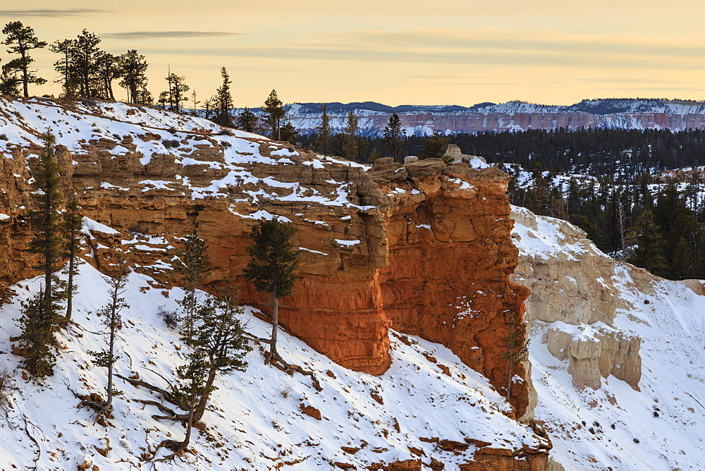 Snowy cliffs of the rim lit by weak winter's late afternoon sun, Bryce Point, Bryce Canyon National Park, Utah, United States of America, North America