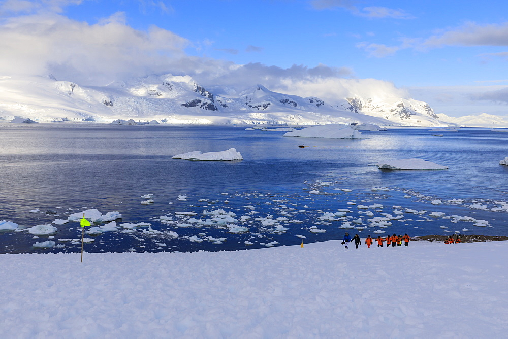 Expedition ship passengers hiking, early morning, beautiful day, Neko Harbour, Graham Land, Antarctic Continent, Antarctica