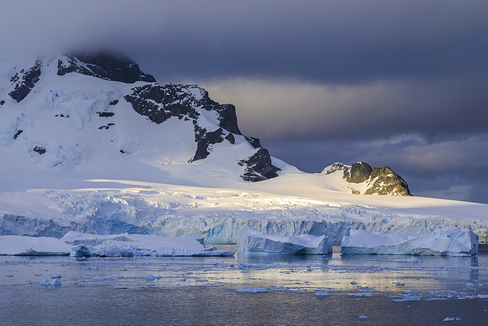Early morning atmospheric cloud, mountains, glaciers and icebergs, Ronge Island, Errera Channel, Antarctic Peninsula, Antarctica, Polar Regions
