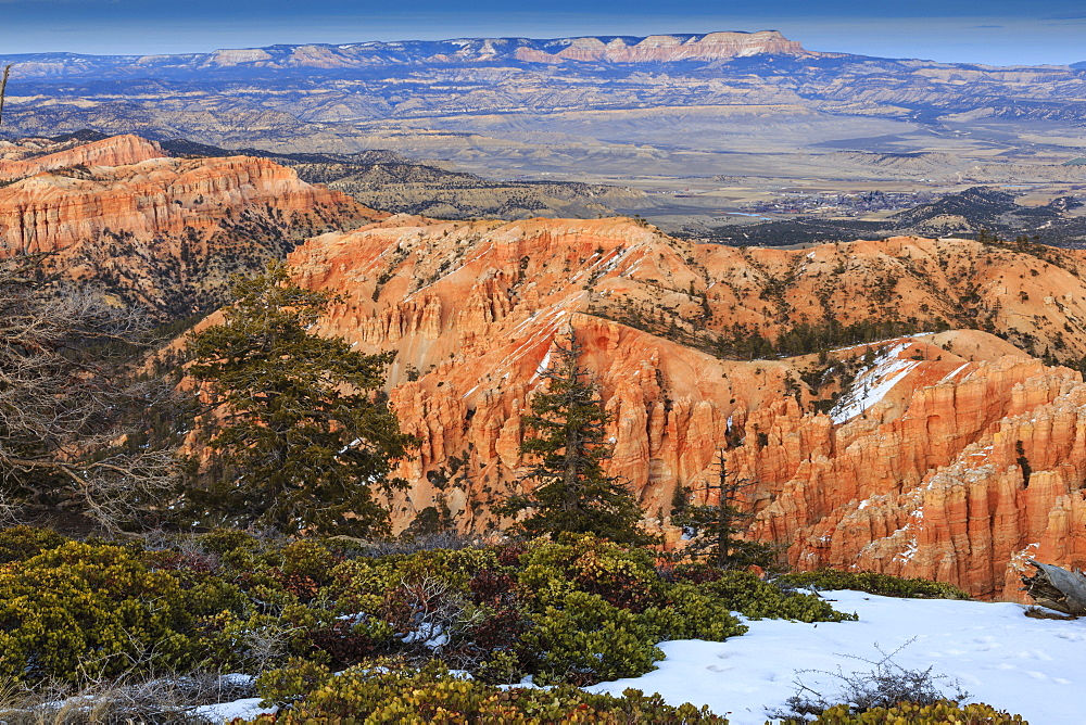 Hoodoos, vegetation and snow with a distant view on a winter's late afternoon, Bryce Point, Bryce Canyon National Park, Utah, United States of America, North America