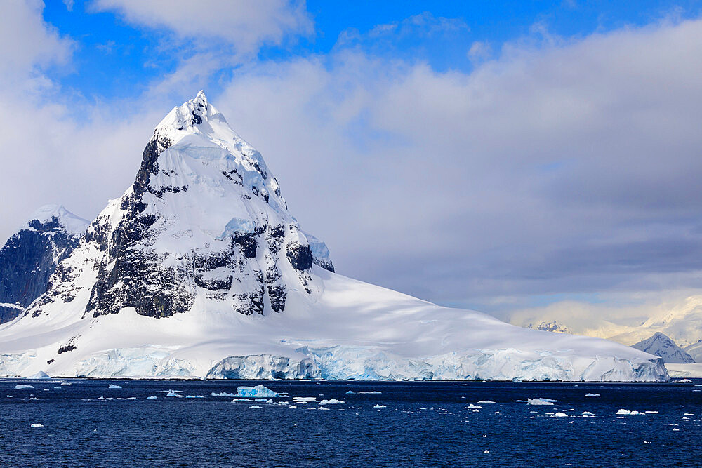 Mountains and glaciers of Cape Errera with blue sky, Wiencke Island, from Bismarck Strait, Antarctic Peninsula, Antarctica, Polar Regions