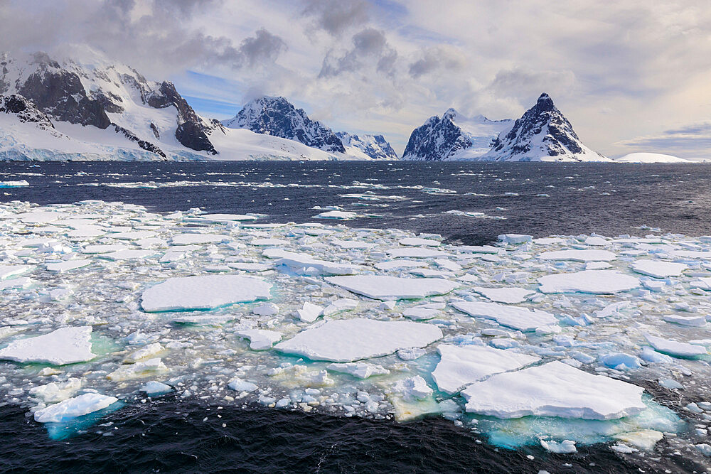Sea ice and Lemaire Channel entrance, between Kiev Peninsula and Booth Island, evening light, Antarctic Peninsula, Antarctica, Polar Regions