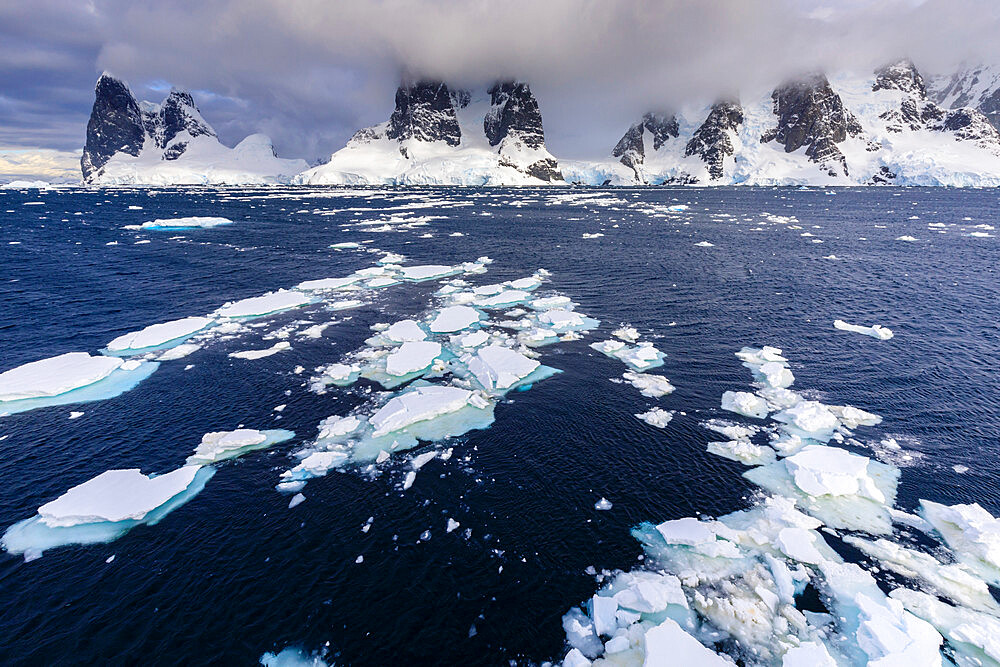 Sea ice off Una Peaks and False Cape Renard, Lemaire Channel entrance, Antarctic Peninsula, Antarctica