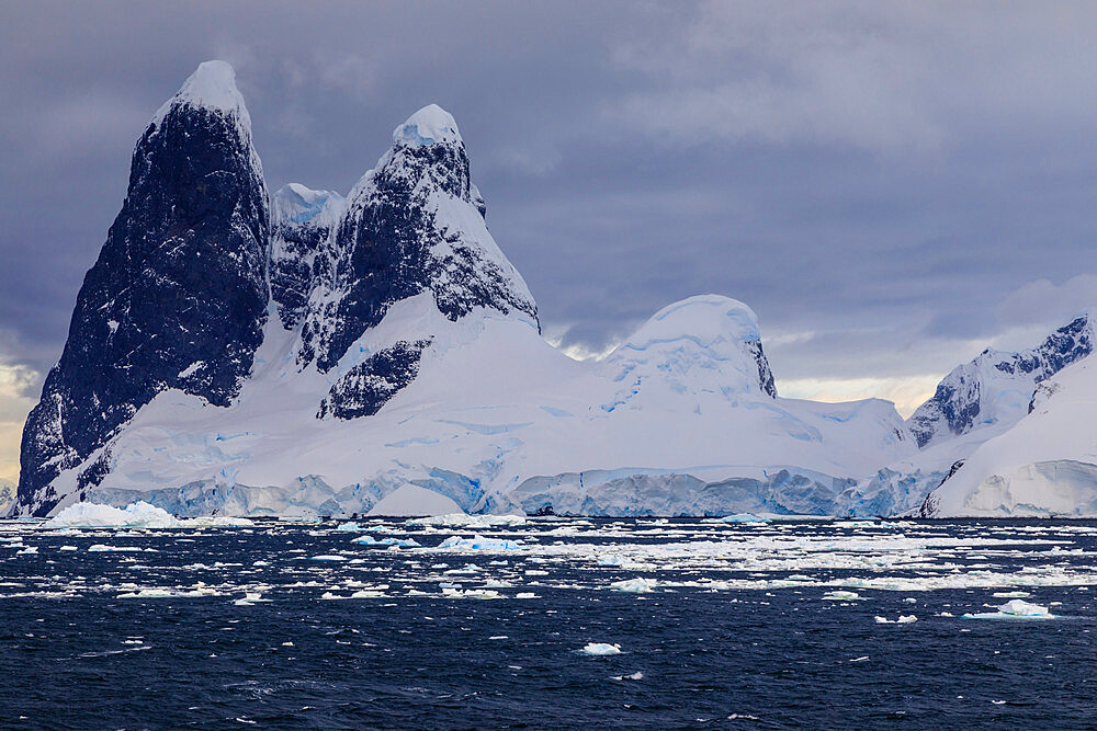 Una Peaks (Una's Tits), basalt ice-capped towers, False Cape Renard, Lemaire Channel entrance, Antarctic Peninsula, Antarctica, Polar Regions