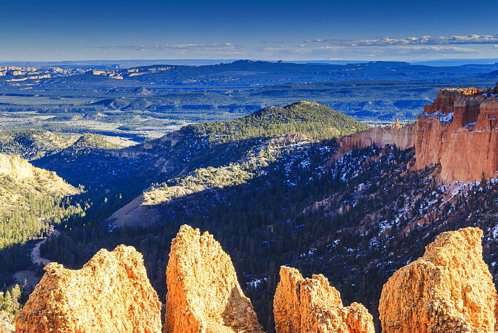 Rocks lit by late afternoon sun with distant view in winter, Paria View, Bryce Canyon National Park, Utah, United States of America, North America