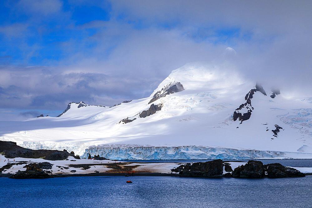 Expedition tourists on Half Moon Island, Livingston Island backdrop, sunny day, South Shetland Islands, Antarctica, Polar Regions