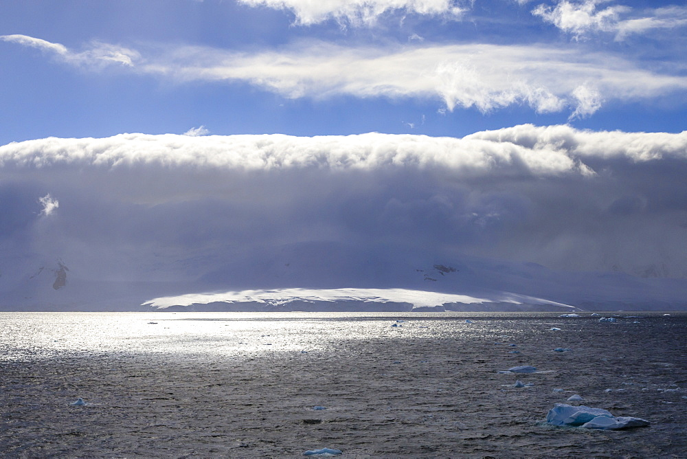 Arcus cloud over the mountains of the Gerlache Strait, blue sky, Antarctic Peninsula, Antarctica