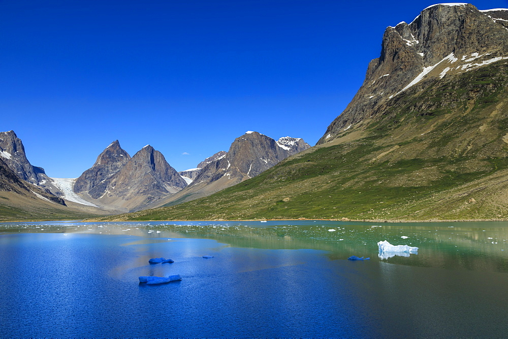 Pyramidal peaks, blue icebergs, glaciers, rugged South Skjoldungen Fjord, glorious weather, remote South East Greenland