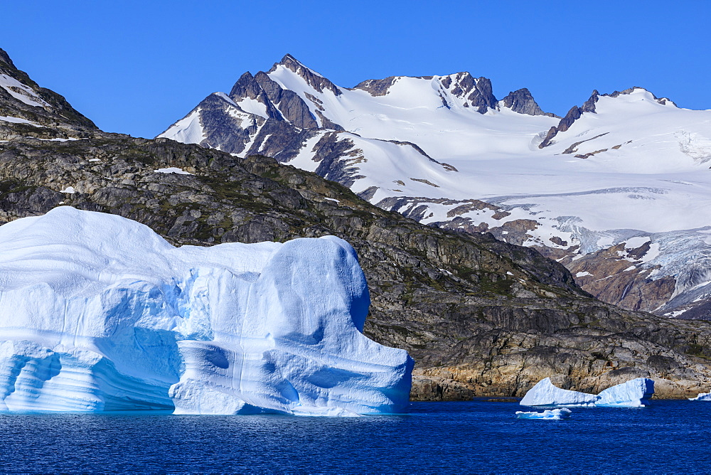 Icebergs, sculptured shapes, King Frederick VI coast at Skjoldungen Fjord, glorious weather, remote South East Greenland