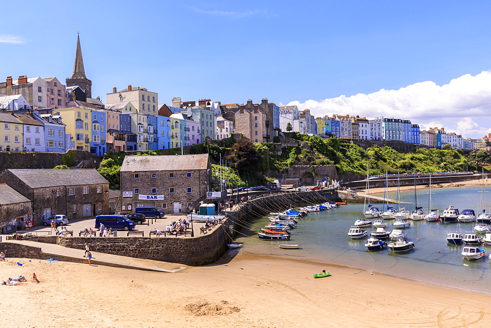 Colourful historic town and St Mary's church, from Harbour Beach, boats, blue sky, hot sunny day, Tenby, Pembrokeshire, Wales