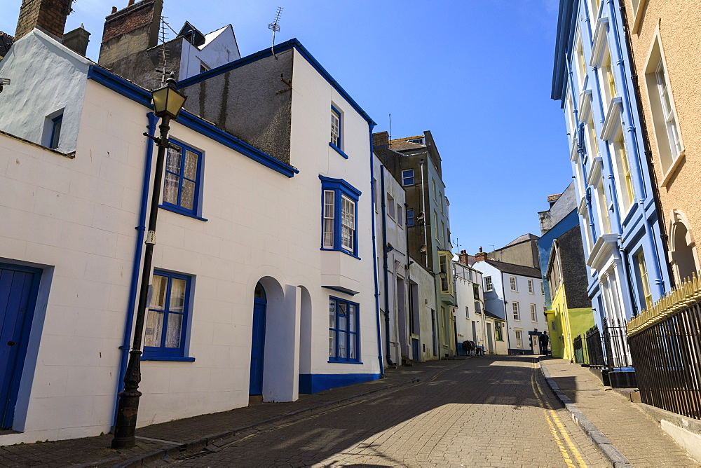 Historic buildings, cobbled street, blue sky, hot sunny day, Tenby, Pembrokeshire, Wales, United Kingdom
