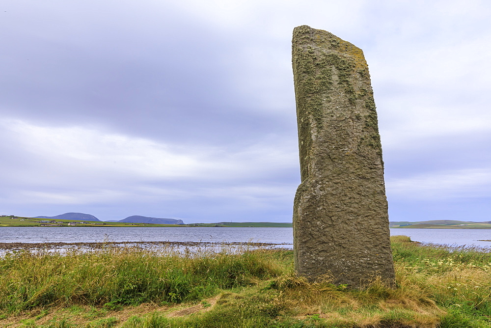 The Watchstone (Watch Stone), Neolithic monolith, Loch of Stenness and Hoy Hills, Brodgar Bridge, Stenness, Orkney, Scotland