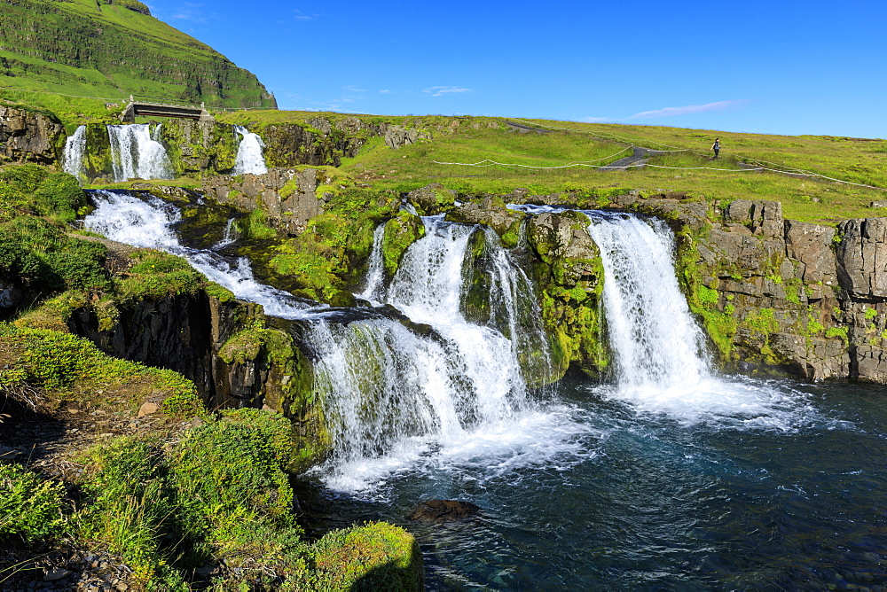 Bridge and Kirkjufellsfoss Waterfall, tourist, Grundarfjordur, blue sky, good Summer weather, Snaefellsnes Peninsula, Iceland