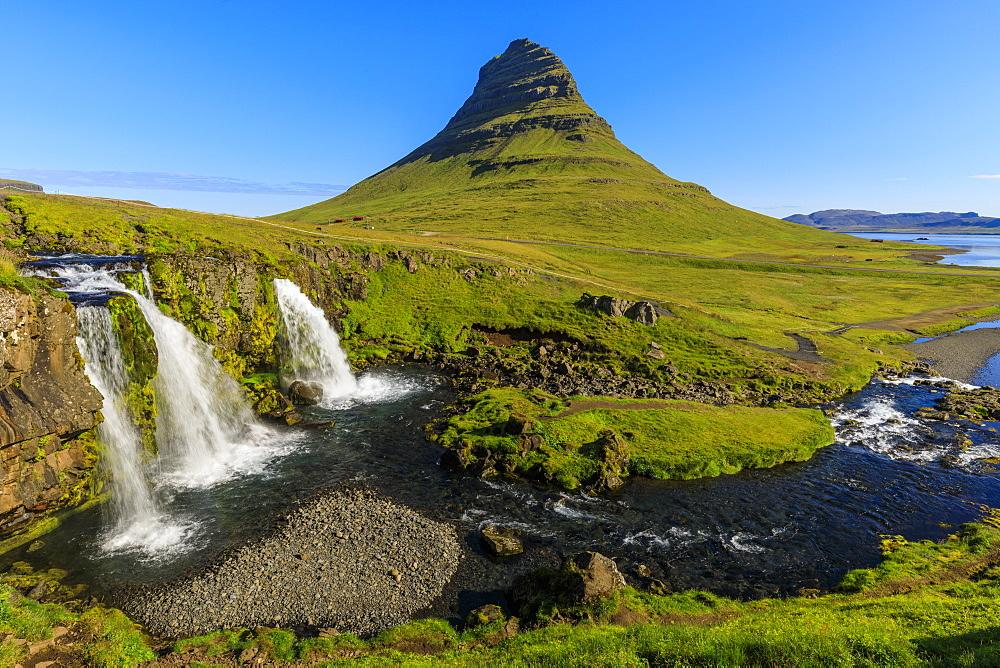 Kirkjufellsfoss Waterfall and Kirkjufell Mountain, sea, Grundarfjordur, good weather, Summer, Snaefellsnes Peninsula, Iceland