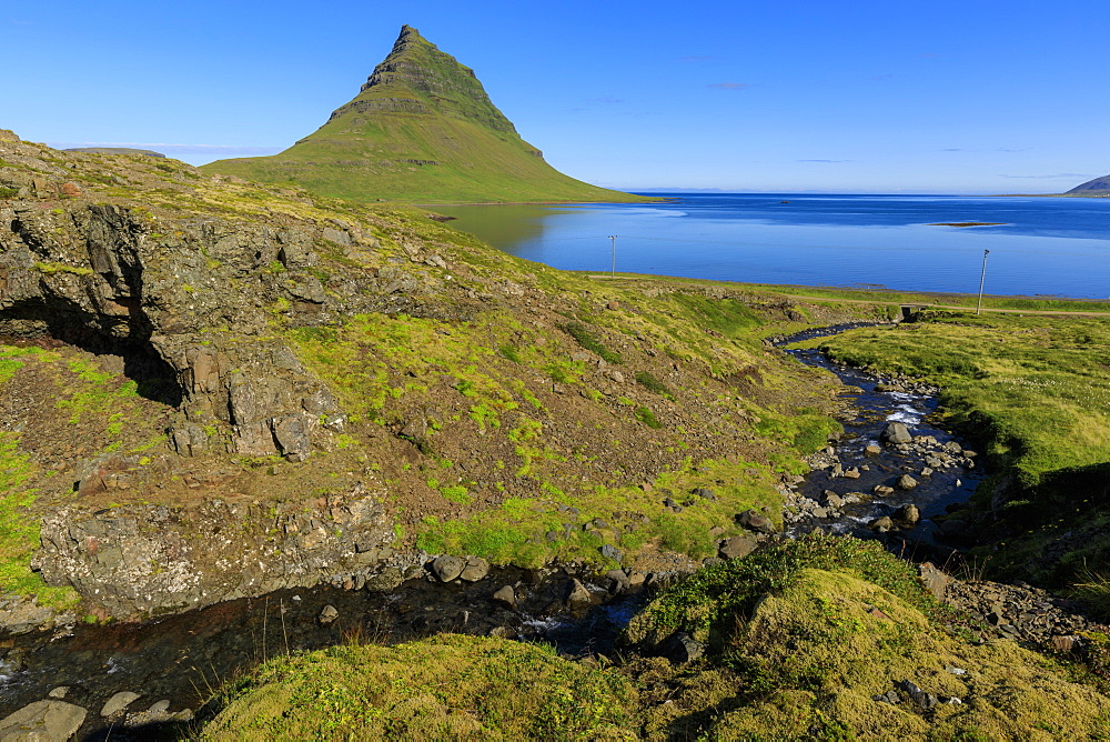 Kirkjufell Mountain, sea and river gorge, Grundarfjordur, blue sky, good weather, Summer, Snaefellsnes Peninsula, Iceland