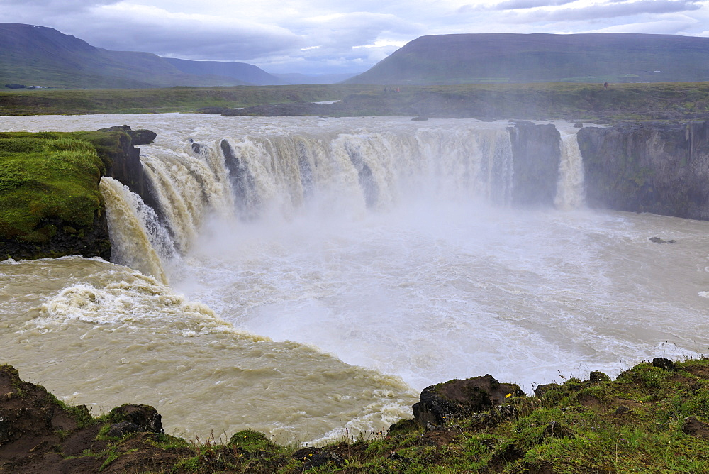 Spray fills the landscape from a spectacular waterfall, Godafoss (Waterfall of the Gods), outside Akureyri, Northern Iceland - 1167-2054