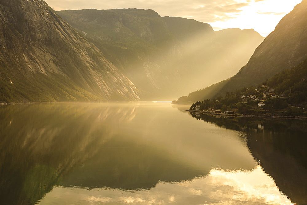 Shafts of light enter misty, beautiful Eidford, fjord reflections, Hardangerfjord, Norwegian Western Fjords, Norway, Europe